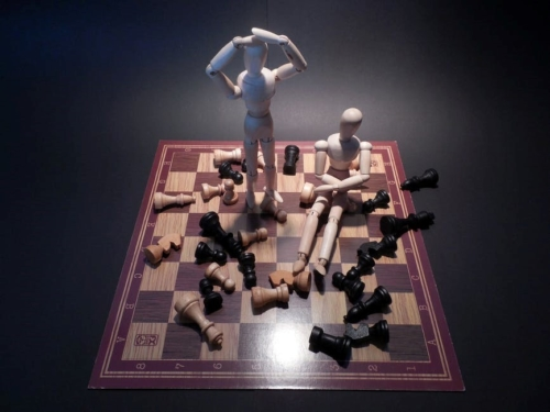 chess with stick figures standing on it