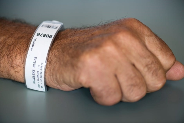 arm with hospital ID bracelet